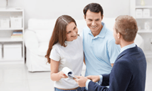 Couple talking to a company representative