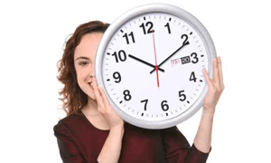 woman holding large clock